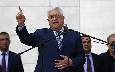 In this photo taken on November 11, 2018, PA President Mahmoud Abbas gives a speech after laying a wreath at the tomb of late Palestinian leader Yasser Arafat inside the Mukataa compound, in the the West Bank city of Ramallah. (Abbas Momani/AFP)