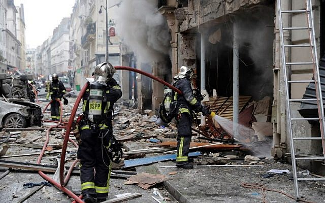 Firefighters intervene after the explosion of a bakery on the corner of the streets Saint-Cecile and Rue de Trevise in central Paris on January 12, 2019. (Thomas Samson/AFP)