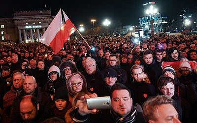 "Thousands of people gather in Warsaw under the slogan ""Stop Hatred"" on January 14, 2019, to protest against violence and honor Pawel Adamowicz, the late mayor of Polish port city Gdansk, who died after being stabbed in the heart by a young man at a weekend charity fundraiser. (Janek Skarzynski/AFP)"