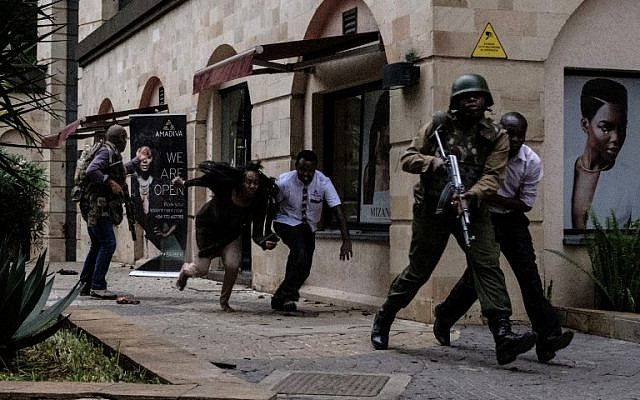 Kenyan security forces help people to escape after a bomb blast at DusitD2 hotel in Nairobi, Kenya, on January 15, 2019. (Kabit Dhanji/AFP)