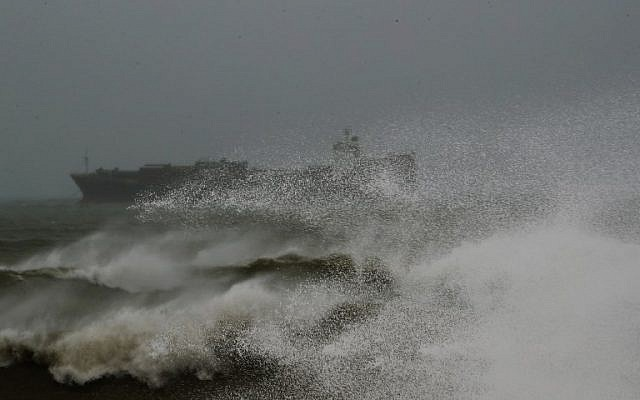 A picture taken on January 16, 2019 shows a cargo ship amidst high waves off of the Lebanese coast in the capital Beirut. (Photo by JOSEPH EID / AFP)