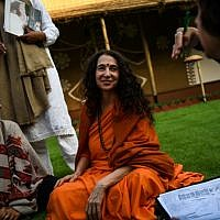 Sadhvi Bhagawati Saraswati, center, the US general secretary of the Global Interfaith WASH Alliance, talks to followers inside her camp at the Kumbh Mela festival in Allahabad, India, January 16, 2019. (CHANDAN KHANNA/AFP)