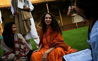 Sadhvi Bhagawati Saraswati, center, the US general secretary of the Global Interfaith WASH Alliance, talks to followers inside her camp at the Kumbh Mela festival in Allahabad, India, January 16, 2019. (CHANDAN KHANNA/AFP)
