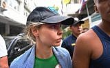 "Detained Belarusian model Anastasia Vashukevich known by her pen name Nastya Rybka leaves Thai immigration department in Bangkok on January 17, 2019 during her deportation together with other associates after pleading guilty in court to multiple charges including solicitation and illegal assembly. - A Belarusian model who claimed she had proof of Russian efforts to help Donald Trump win office is to be deported after being convicted on January 15 nearly a year after her arrest in Thailand for participating in a ""sex training course"". (Photo by Lillian SUWANRUMPHA / AFP)"