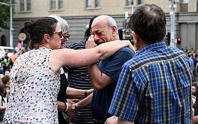 People attend a vigil in memory of murdered Israeli student Aya Maasarwe in Melbourne on January 18, 2019.(Allan LEE / AFP)