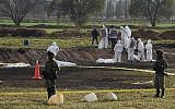 A group of forensic experts work at the site of a massive blaze triggered by a leaky pipeline in Tlahuelilpan, Hidalgo state, Mexico on January 19, 2019. ( ALFREDO ESTRELLA / AFP)