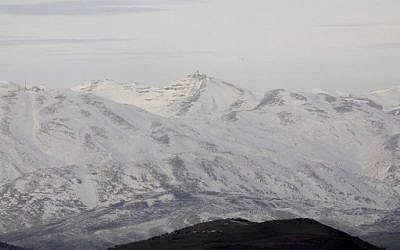 A picture taken from the Israeli side of the Golan Heights shows snow covered mountain inside Syria on January 20, 2019. (Jalaa Marey/AFP)