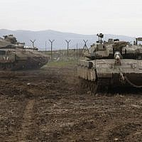 Israeli army Merkava tanks take positions on the Golan Heights, on January 20, 2019. (Jalaa Marey/AFP)