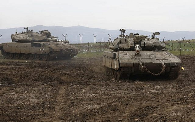 Israeli army Merkava tanks take positions in the Golan Heights, on January 20, 2019. (JALAA MAREY / AFP)