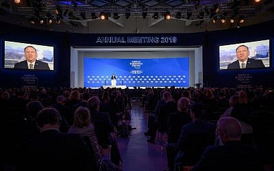 US Secretary of State Mike Pompeo is seen on screens during his address via satellite at the World Economic Forum (WEF) annual meeting, on January 22, 2019 in Davos, eastern Switzerland. (Fabrice Coffrini/AFP)