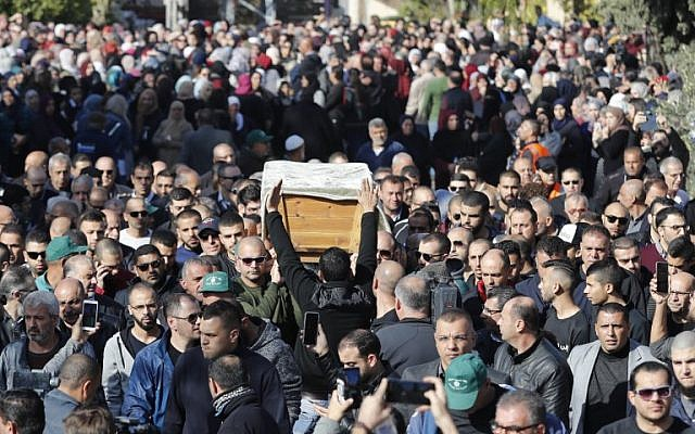 Mourners carry the coffin of Israeli student Aya Maasarwe during her funeral in the northern town of Baqa al-Gharbiya, on January 23, 2019. (Ahmad GHARABLI/AFP)