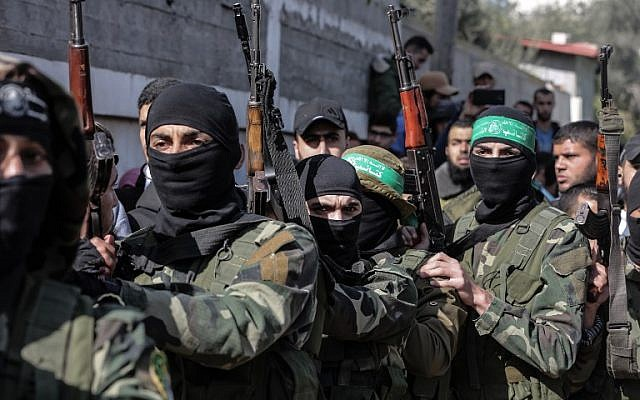 Masked Hamas gunmen attend the funeral of Mahmoud al-Nabaheen, 24, in the Bureij refugee camp, in the central Gaza Strip, on January 23, 2019. (Mahmud Hams/AFP)