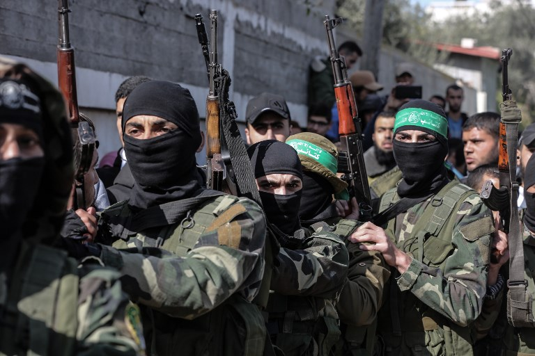 1ef64d4f5fb Masked Hamas gunmen attend the funeral of Mahmoud al-Nabaheen
