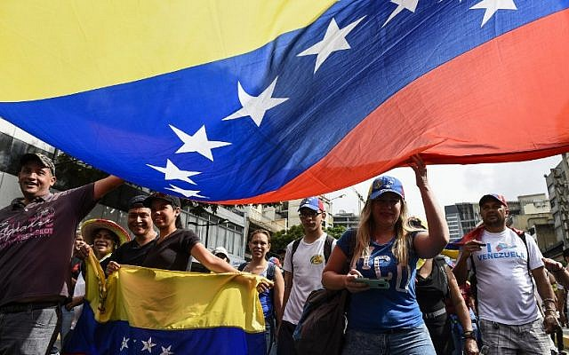 Venezuelan opposition supporters take part in a march on the anniversary of the 1958 uprising that overthrew the military dictatorship in Caracas on January 23, 2019. (Federico Parra / AFP)