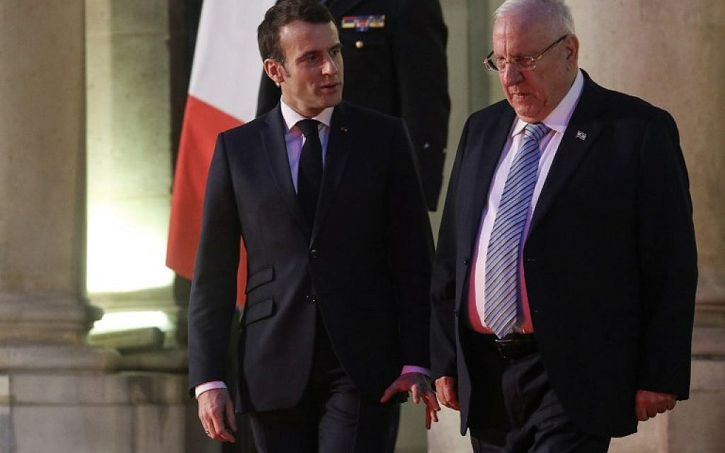 President Reuven Rivlin (R) is accompanied by French President Emmanuel Macron after their meeting at the Elysee Palace in Paris on January 23, 2019. (ludovic MARIN / AFP)