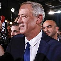 Former IDF chief of staff Benny Gantz (C) is greeted by supporters as he arrives to give his first electoral speech in the coastal city of Tel Aviv on January 29, 2019. (Jack Guez/AFP)