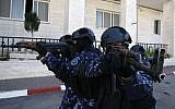 Palestinian policemen participate in a training session at their headquarters in the West Bank city of Hebron on January 30, 2019. (HAZEM BADER / AFP)