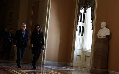 US Senate Majority Leader Sen. Mitch McConnell (R-KY) walks towards the Senate chamber with Secretary for the Majority Laura Dove (R) January 28, 2019 at the U.S. Capitol in Washington, DC. (Alex Wong/Getty Images/AFP)