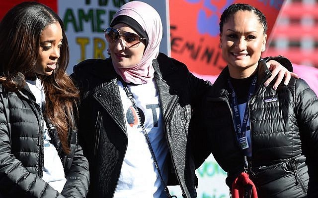 "From left to right, Tamika Mallory, Linda Sarsour and Carmen Perez at the Women's March ""Power to the Polls"" voter registration tour launch at Sam Boyd Stadium in Las Vegas, January 21, 2018. (Ethan Miller/Getty Images via JTA)"