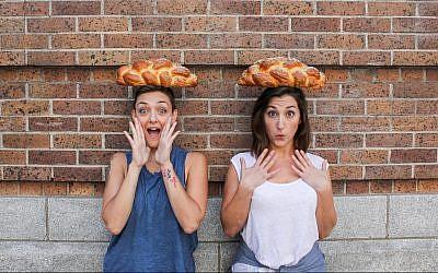 Elina Tilipman, left, and Sarah Klegman founded Challah Hub. (Sally Claire Photography/via JTA)