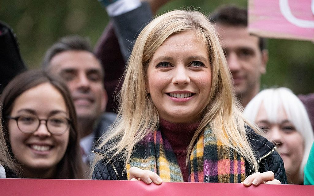 Rachel Riley poses with campaigners outside of the Houses of Parliament in London before delivering a petition to Downing Street, October 8, 2018. Riley has spoken out in recent months about her Jewish identity and the anti-Semitic abuse she has received online. (Handout/Tom Nicholson for Bauer Media via Getty Images/via JTA)