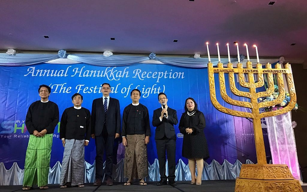 Sammy Samuels, second from right, sings at a Hanukkah event with Burmese leaders. Israel's ambassador to Myanmar, Ronen Gilor, is third from left; between them is Phyo Min Thein, the chief minister of the Yangon region, Dec. 7, 2018. (Charles Dunst)