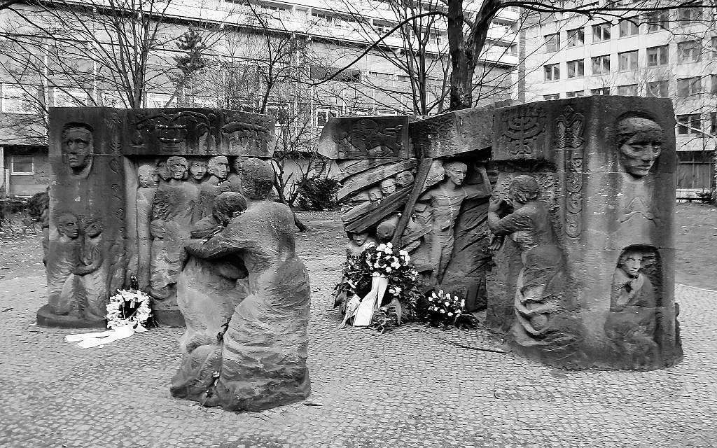 The memorial to the 1943 German Jewish women's protest. The sculpture shows women protesting and the men behind bars. In the distance one can see remnants of the Old Synagogue wall. (Courtesy Walkowitz)