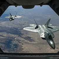 Two Air Force F-22 Raptors fly over Syria, February 2, 2018, while supporting Operation Inherent Resolve. (US Air National Guard/Staff Sgt. Colton Elliott)