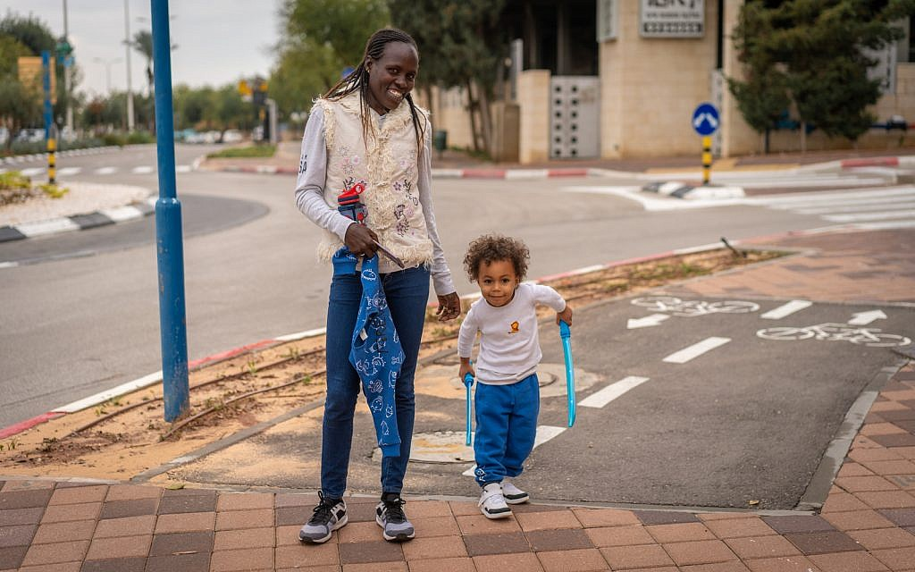 Lonah Chemtai Salpeter with her son, Roy, outside their home in Shoham, central Israel, December 9, 2018. (Luke Tress/Times of Israel)