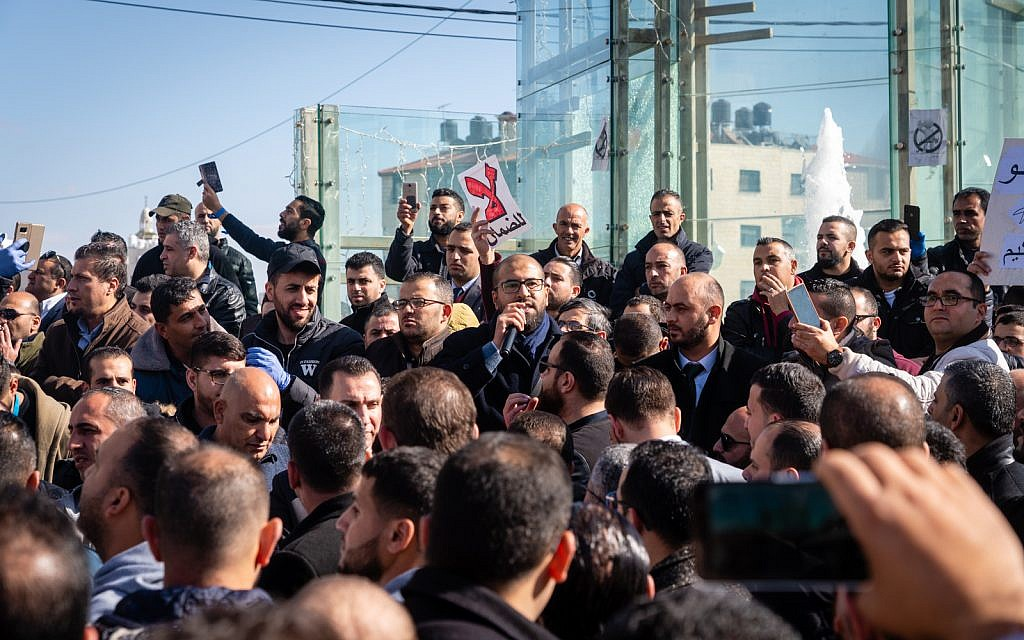 Palestinians protest against a government tax hike in Ramallah, West Bank, December 12, 2018. (Luke Tress/Times of Israel)