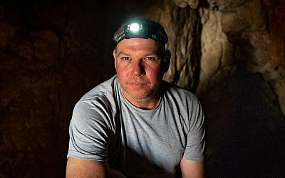 Researcher Oren Gutfeld inside Cave 52 at the Qumran archaeological site, January 22, 2019. (Luke Tress/Times of Israel)