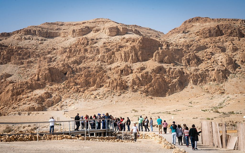 Visitors at the Qumran archaeological site, January 22, 2019. (Luke Tress/Times of Israel)