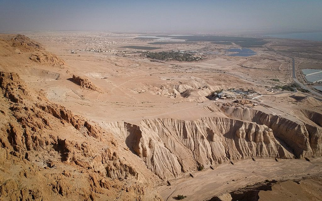 A view of the Qumran archaeological site from a recently excavated Dead Sea Scroll cave above, January 22, 2019. (Luke Tress/Times of Israel)