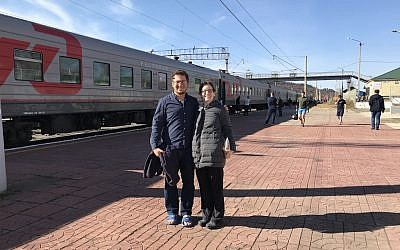 The author and her husband on a break during the ride from Ulan Ude to Vladivostok at the Skovorodinskiy Rayon Station. (Rossella Tercatin/ Times of Israel)