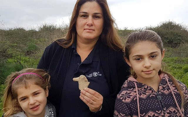 From left: Maya, Ayellet, and Hadas Goldberg, who discovered an Iron Age horse figurine after a rain near Beit She'an. (Nir Distelfeld, Israel Antiquities Authority)