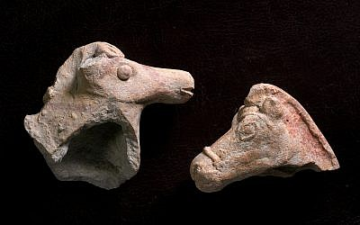 Left: 2,800-year-old Iron Age horse figurine which was discovered after a rain near Beit She'an. Right: 2,200-year-old, Hellenistic-era horse figurine discovered near Tel Akko. (Clara Amit, Israel Antiquities Authority)