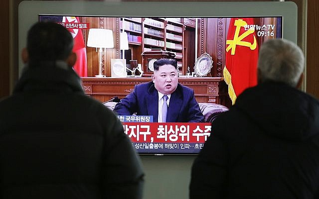 """People watch a TV news on a screen showing North Korean leader Kim Jong Un's New Year's speech, at Seoul Railway Station in Seoul, South Korea, Tuesday, Jan. 1, 2019. The letters on the screen read: """" North Korean leader Kim Jong Un's New Year Speech."""" North Korean leader Kim says he hopes to extend his high-stakes nuclear summitry with President Donald Trump into 2019, but also warns Washington not to test North Koreans' patience with sanctions and pressure.(AP Photo/Ahn Young-joon)"""