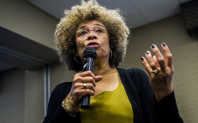 Angela Davis speaks at the University of Michigan-Flint in 2015. (Jake May/The Flint Journal via AP, File)