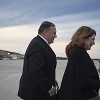US Secretary of State Mike Pompeo and his wife Susan Pompeo walk to the plane prior to departing from Joint Base Andrews on January 7, 2019. (Andrew Caballero-Reynolds/Pool Photo via AP)