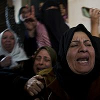 Relatives of Amal al-Taramsi mourn during her funeral in Gaza City, January 12, 2019. (AP Photo/Khalil Hamra)