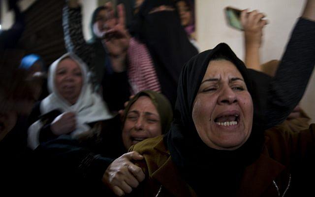 Relatives of Amal al-Taramsi mourn during her funeral in Gaza City, January 12, 2019. (AP Photo/Khalil Hamra)