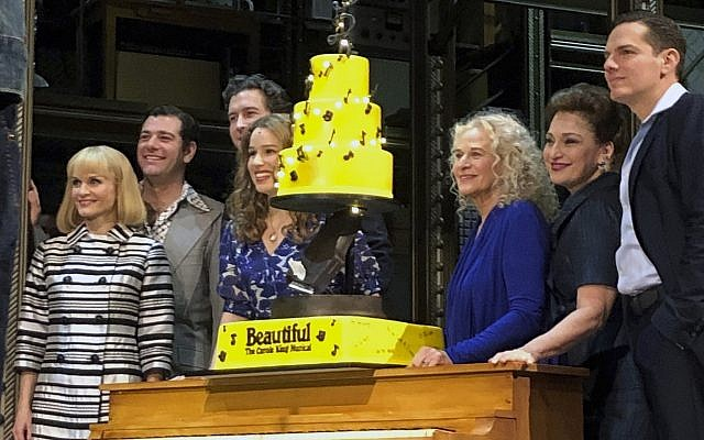 Carole King, third from right, poses for photos with the cast of 'Beautiful: The Carole King Musical' at the Stephen Sondheim Theater after a performance in New York, January 12, 2019. (Brooke Lefferts/AP)
