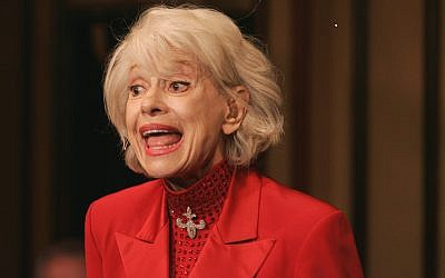 "In this Oct. 18, 2005 file photo, Carol Channing performs during her one woman show,""The First 80 Years are the Hardest,"" at the cabaret Feinstein's at the Regency in New York.  Channing, whose career spanned decades on Broadway and on television has died at age 97. Publicist B. Harlan Boll says Channing died of natural causes early Tuesday, Jan. 15, 2019 in Rancho Mirage, Calif.  (AP Photo/Richard Drew)"