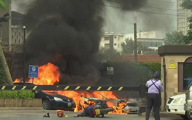 This frame taken from video shows a scene of an explosion in Kenya's capital, Nairobi, January 15, 2019. (AP Photo/Josphat Kasire)