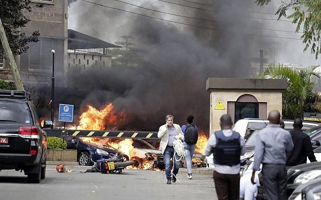 Fire and smoke rise from the scene of an explosion in Nairobi, Kenya on Tuesday, January 15, 2019. (AP Photo/Khalil Senosi)