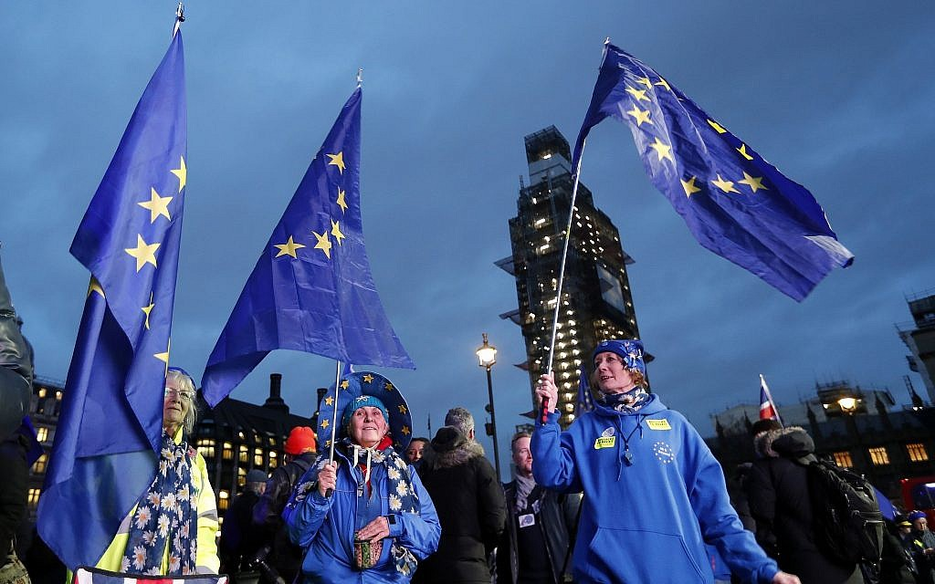 Pro-European demonstrators hold EU flags at Parliament Square in London, Tuesday, January 15, 2019. (AP Photo/Frank Augstein)