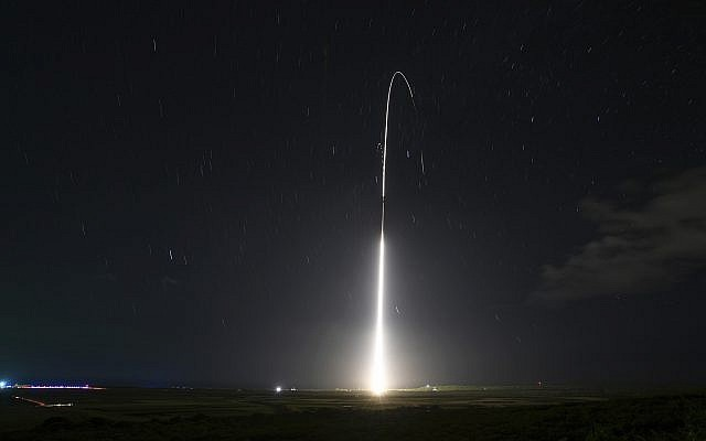 his Dec. 10, 2018, file photo, provided by the U.S. Missile Defense Agency (MDA),shows the launch of the U.S. military's land-based Aegis missile defense testing system, that later intercepted an intermediate range ballistic missile, from the Pacific Missile Range Facility on the island of Kauai in Hawaii. The Trump administration will roll out a new strategy Thursday, Jan. 17, 2019, for a more aggressive space-based missile defense system to protect against existing threats from North Korea and Iran and counter advanced weapon systems being developed by Russia and China. (Mark Wright/Missile Defense Agency via AP)