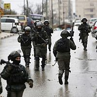 Israeli forces deploy during a raid in the West Bank City of Ramallah. January 9, 2019 (AP Photo/Majdi Mohammed, File)