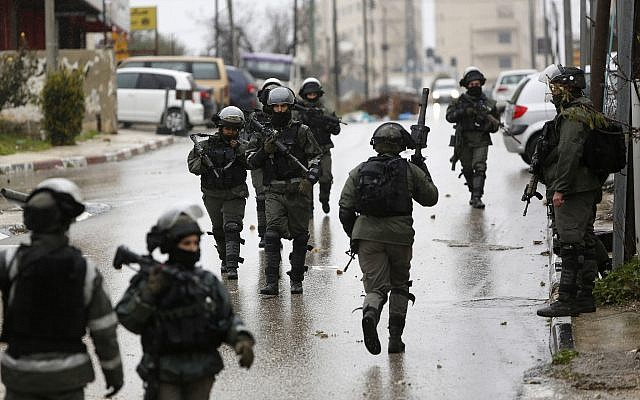 Illustrative: Israeli forces deploy during a raid in the West Bank City of Ramallah. January 9, 2019 (AP Photo/Majdi Mohammed, File)