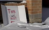 A sign reading 'This was not okay,' is seen in front of Covington Catholic High School in Park Kills, Ky., January 20, 2019. (Bryan Woolston/AP)